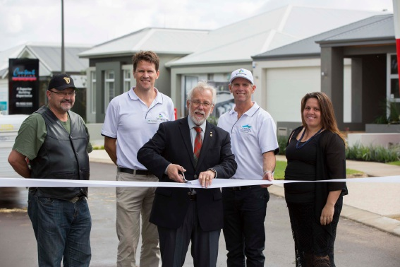 More than 1500 people attended the opening. City of Armadale mayor Henry Zelones cuts the ribbon to officially open the Springtime display village in Haynes.