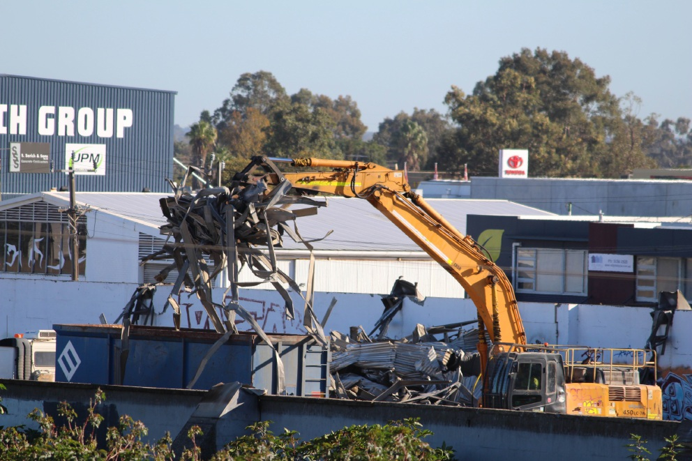 A clawed excavator at work at the old bulk grain site. Picture: J Bianchini