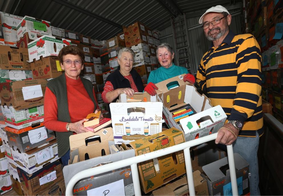 Curly Vasoli, June Fry, Margaret Cabassi and Rick France prepare for the book sale. Picture: Matt Jelonek www.communitypix.com.au d454641