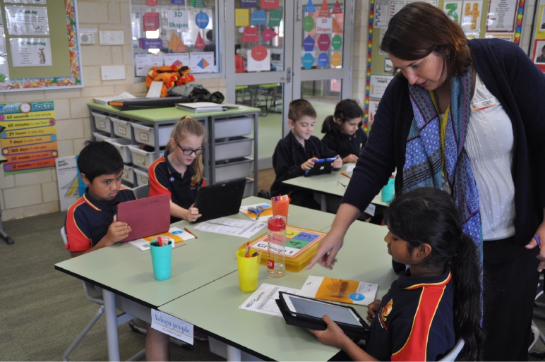 Teacher Narelle Salomon and some of her students using their own tablets.
