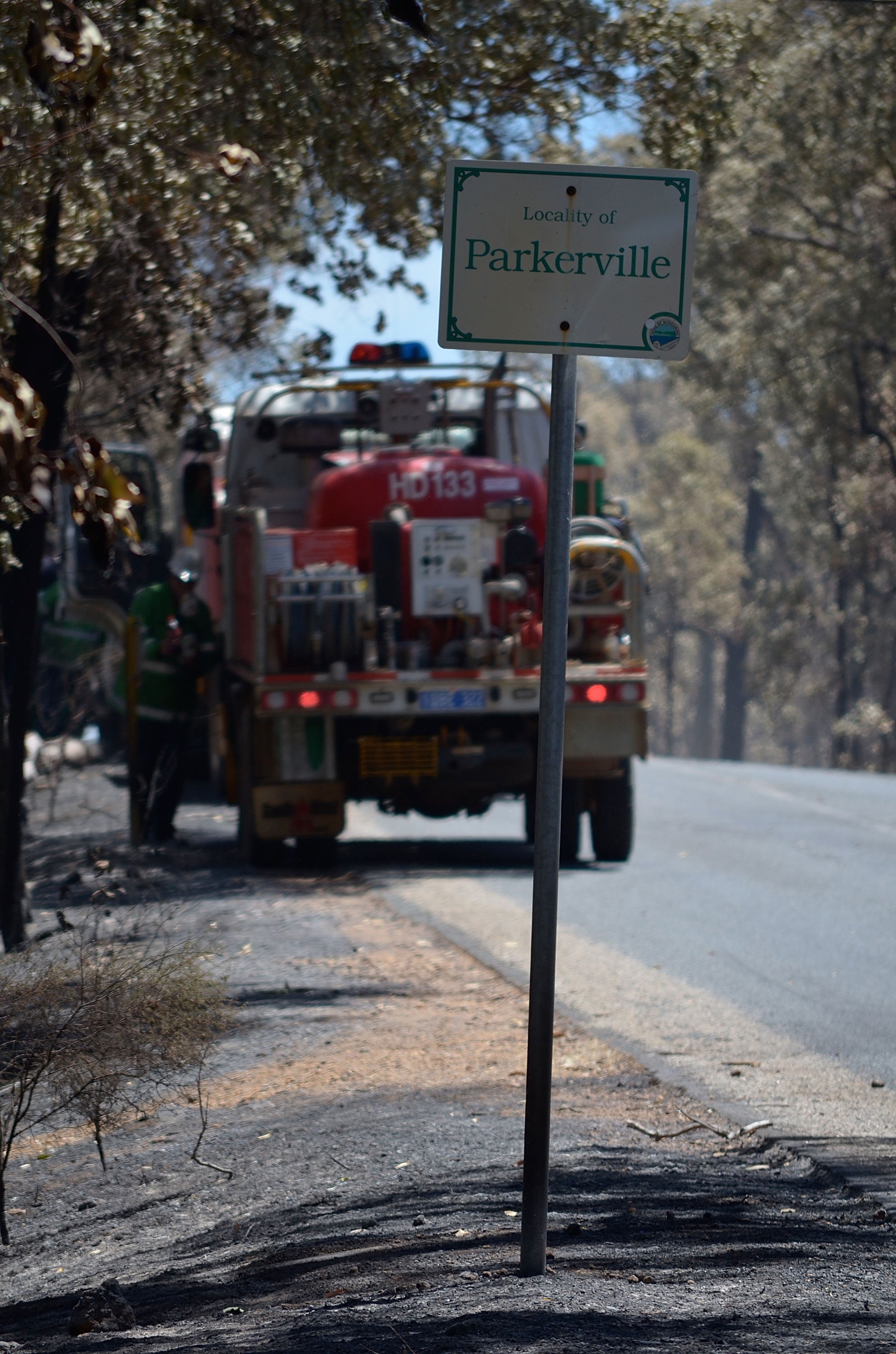 In this handout photo provided by DFES, A fire truck is parked on the roadside in Parkerville in Perth's hills on January 13, 2014.