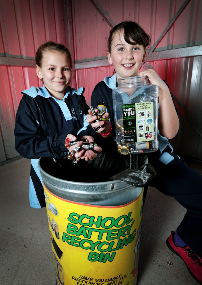 Tayha Duff and Sahara Jauncey collecting batteries for Earth Day.   |Picture: David Baylis d454386