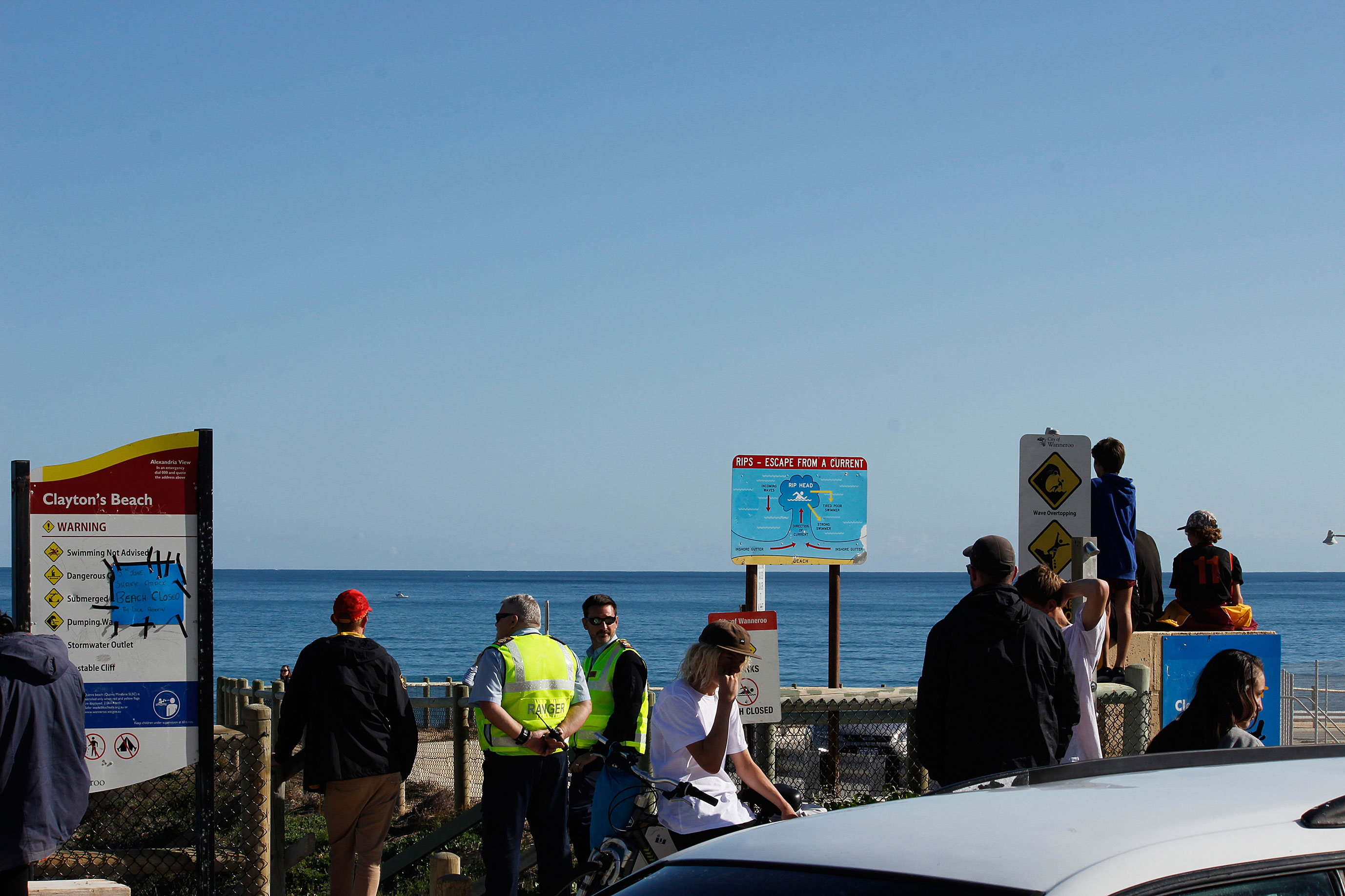 Mindarie beaches have been closed as authorities hunt the shark that killed a woman yesterday morning.