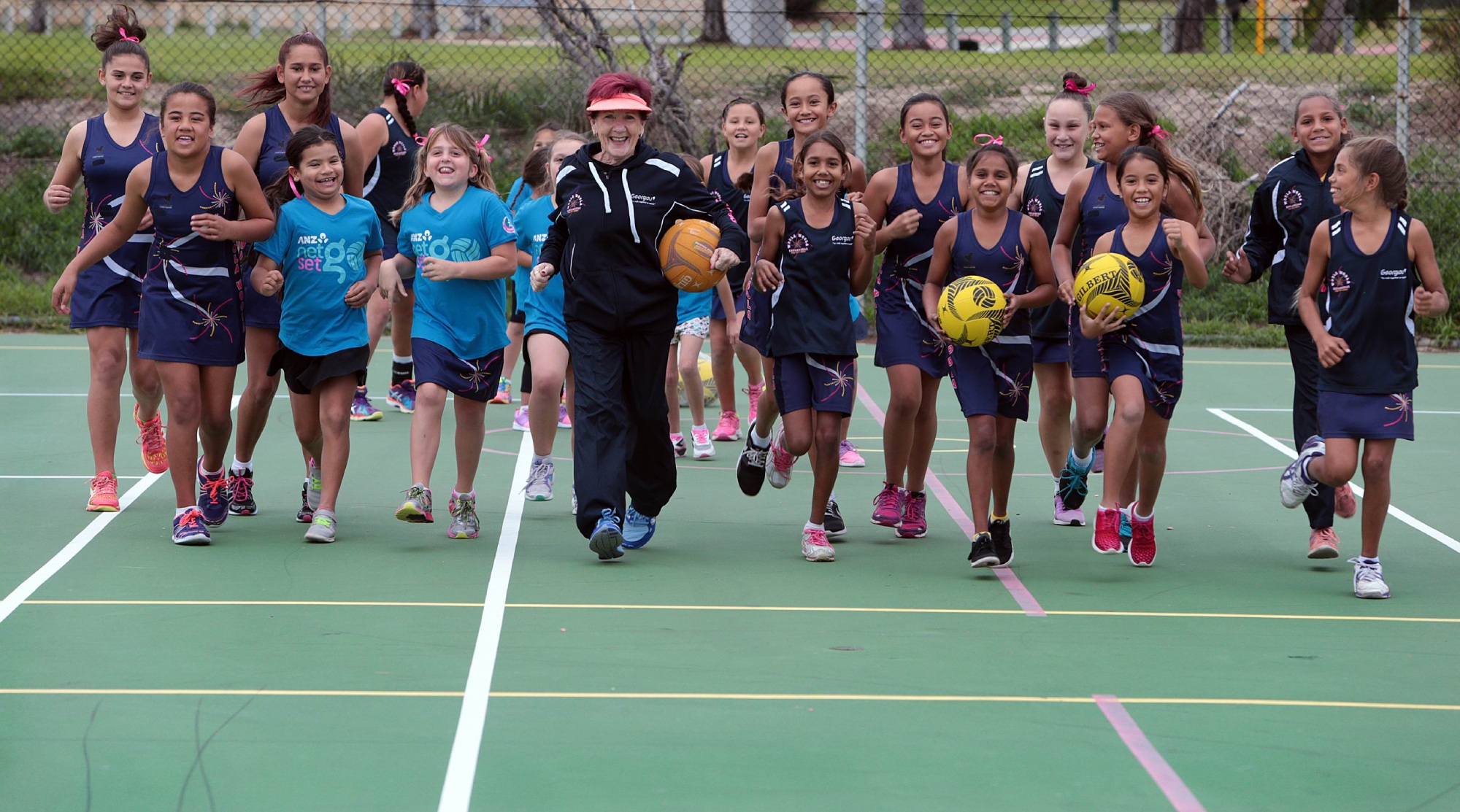 Rusty Hazel with the Woola Woola Koolangkas netball team.