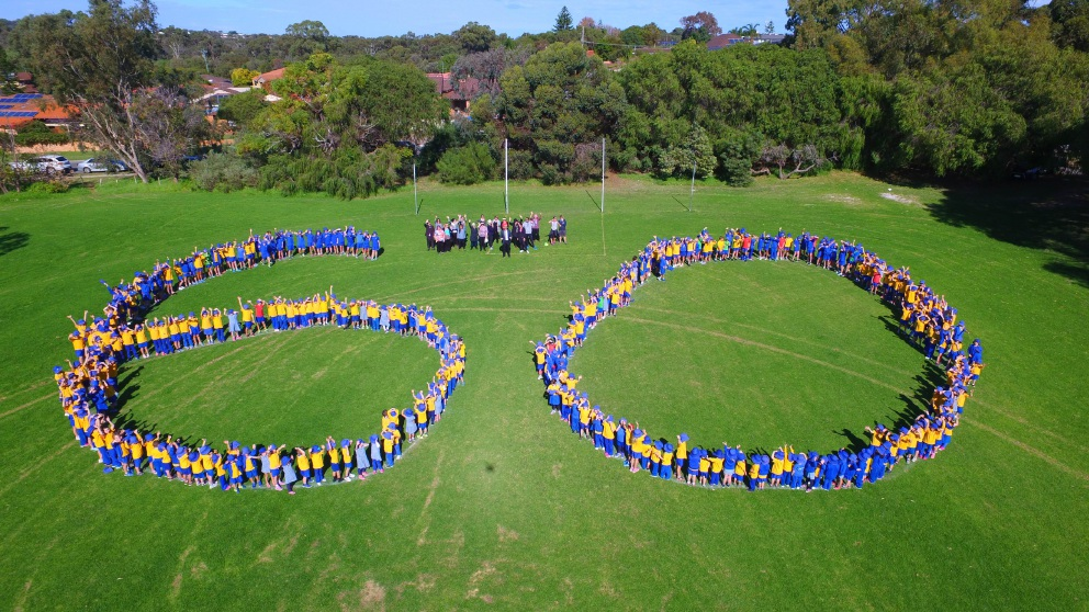 Marmion Primary School students form a giant 60 on the school oval.