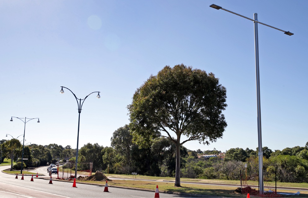Straight-arm light poles are replacing Joondalup Drive's curved variety. d455089
