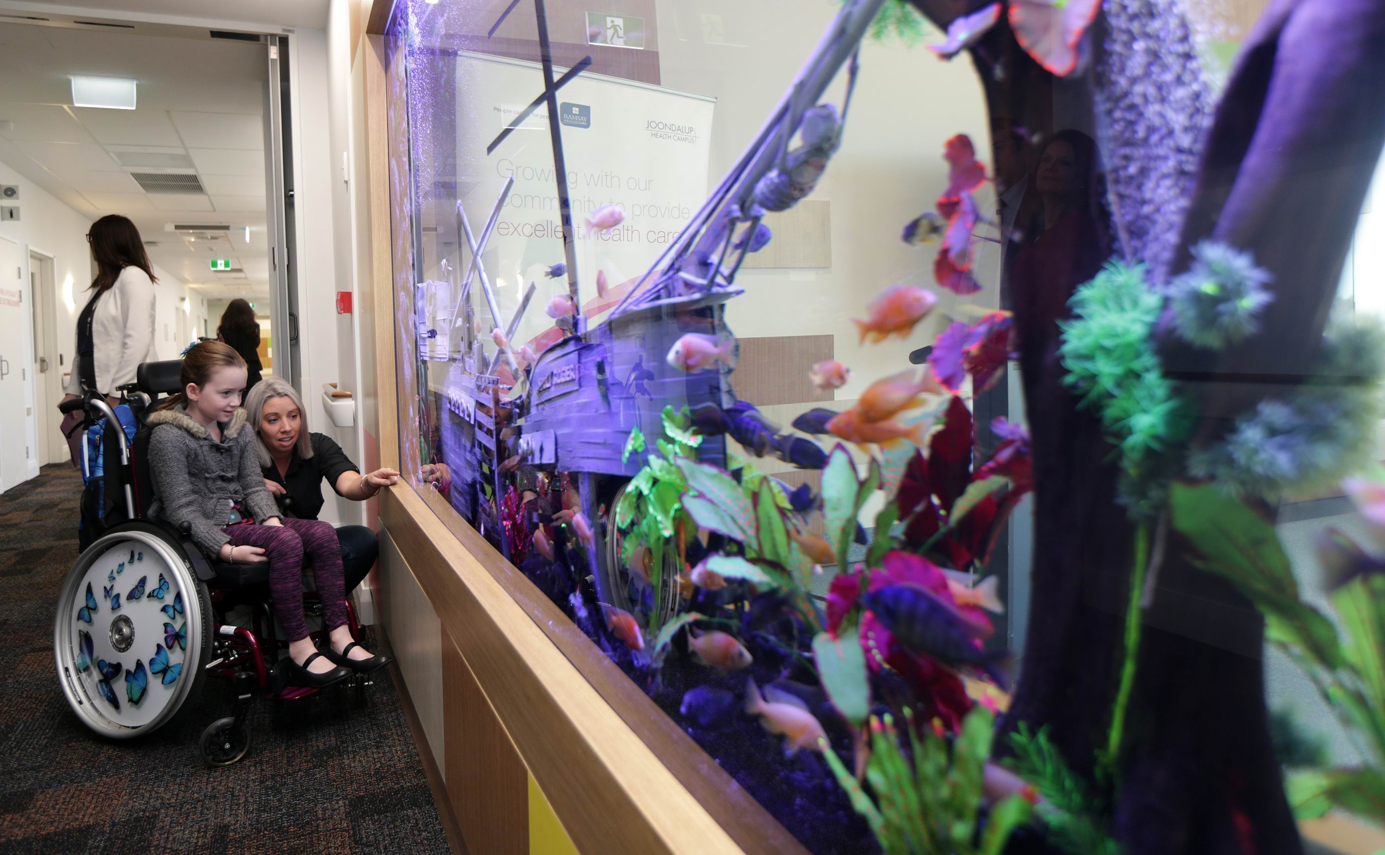 Jo Harrington (Carramar) and her daughter Lux (8) check out the aquarium in the new children's ward. Picture: Martin Kennealey