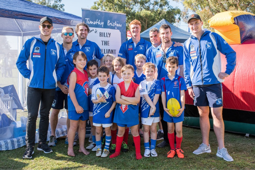 Tim Bristow with some of his East Fremantle teammates and children at the launch of his new book. Picture: Georga McMullen
