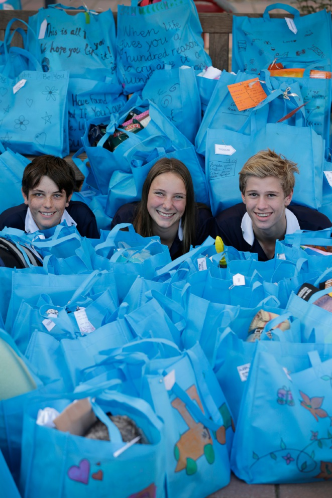 Year 9 students Ashley Setterfield, Clarie Stagoll and Lucas Cornelius with care bags. Picture: Andrew Ritchie www.communitypix.com.au   d455093