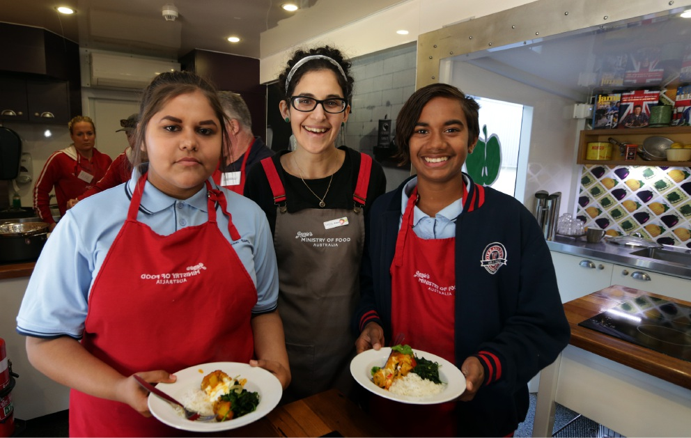 Food trainer Alex Taucher with students Zakiah-Lee Corbett (Year 9) and Jamison Ugle (Year 8). Picture: Martin Kennealey www.communitypix.com.au   d454800