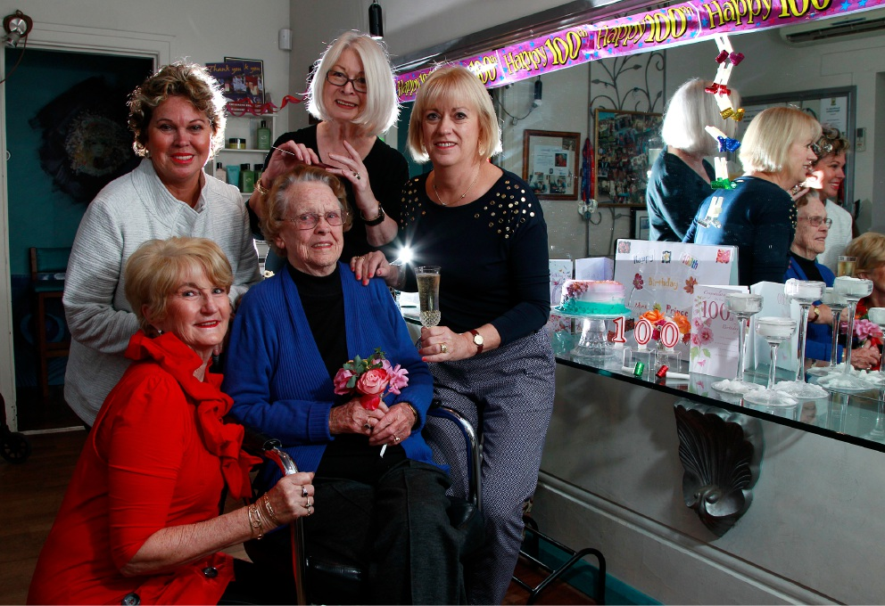 100 year old Gwen Prince (centre) with her daugthers Emelia Green (white top left) and Joan Spry (right with glass) and her hairdresser Jan Clark (centre back) and Nola Forknall. Picture: Marie Nirme d454883