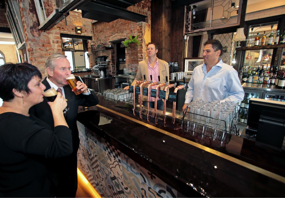 Tourism Minister Alyssa Hayden and Premier Colin Barnett, with Publican Group Australia directors John Ahern and Steve Garcia, serving the first beer at the newly refurbished Guildford Hotel. Picture: David Baylis d454716