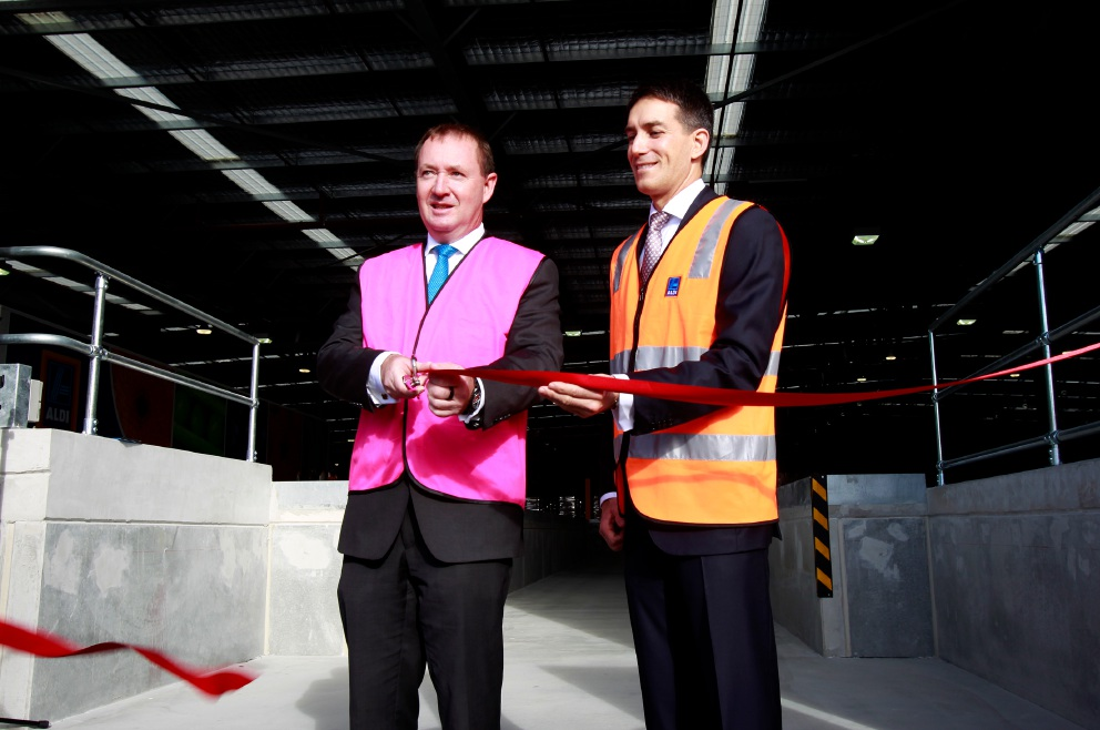 Aldi WA state managing direct Damien Scheidel (right) and Member for Jandakot Joe Francis cutting the ribbon at the new distribution centre. Picture: Marie Nirme d454210