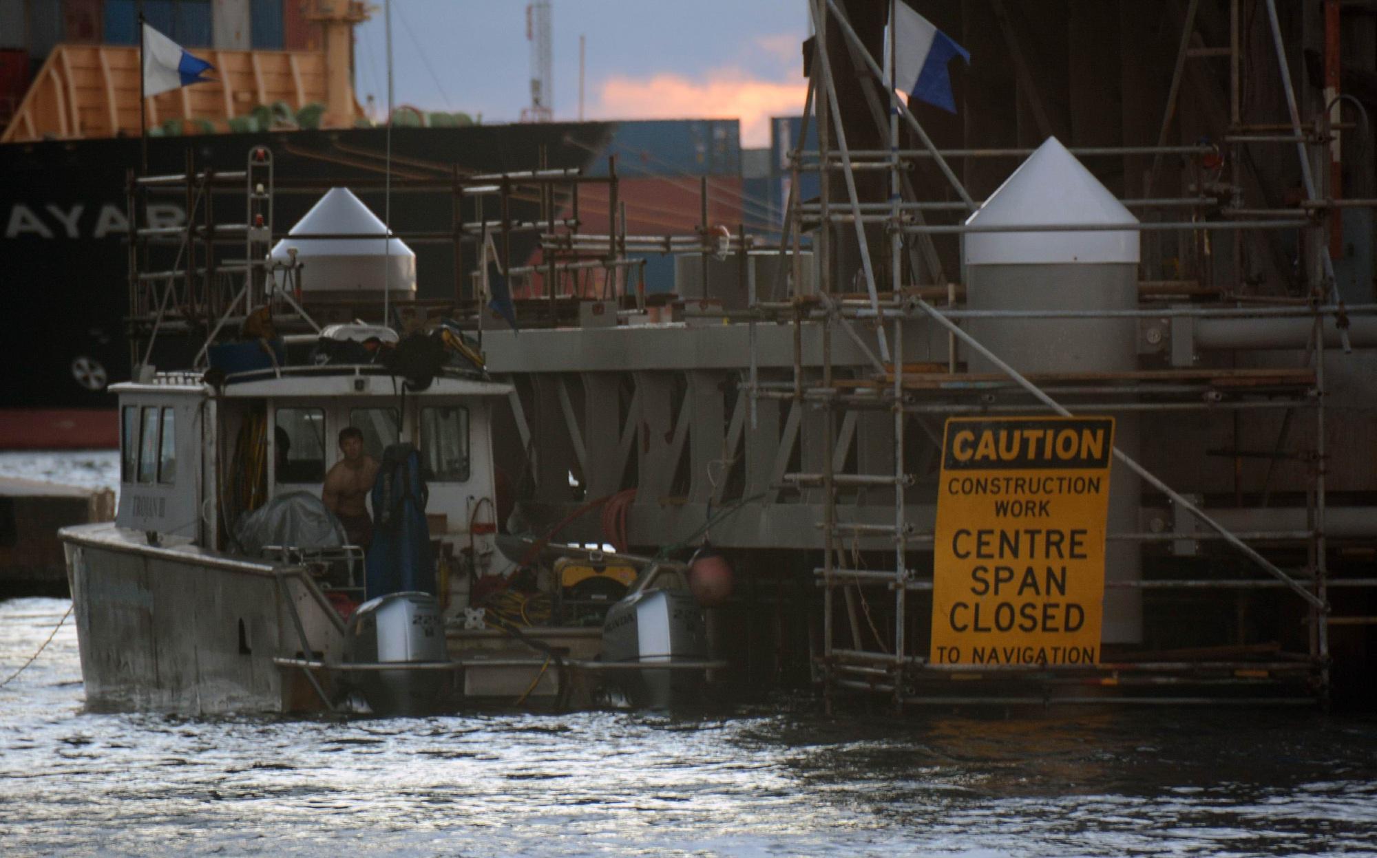 Divers working on the bridge. Picture: Jon Bassett