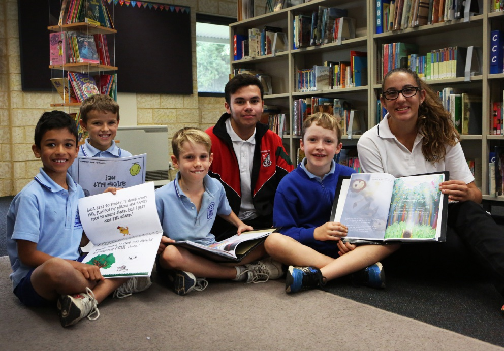 Year 3 Attadale PS Students Xavier Silvester, Ben O''Keeffe, Michael Luger and Zachary Debenham with Year 10 Applecross Senior High School students David Malcolm and Anita Loschiavo. Picture: Matt Jelonek d452161