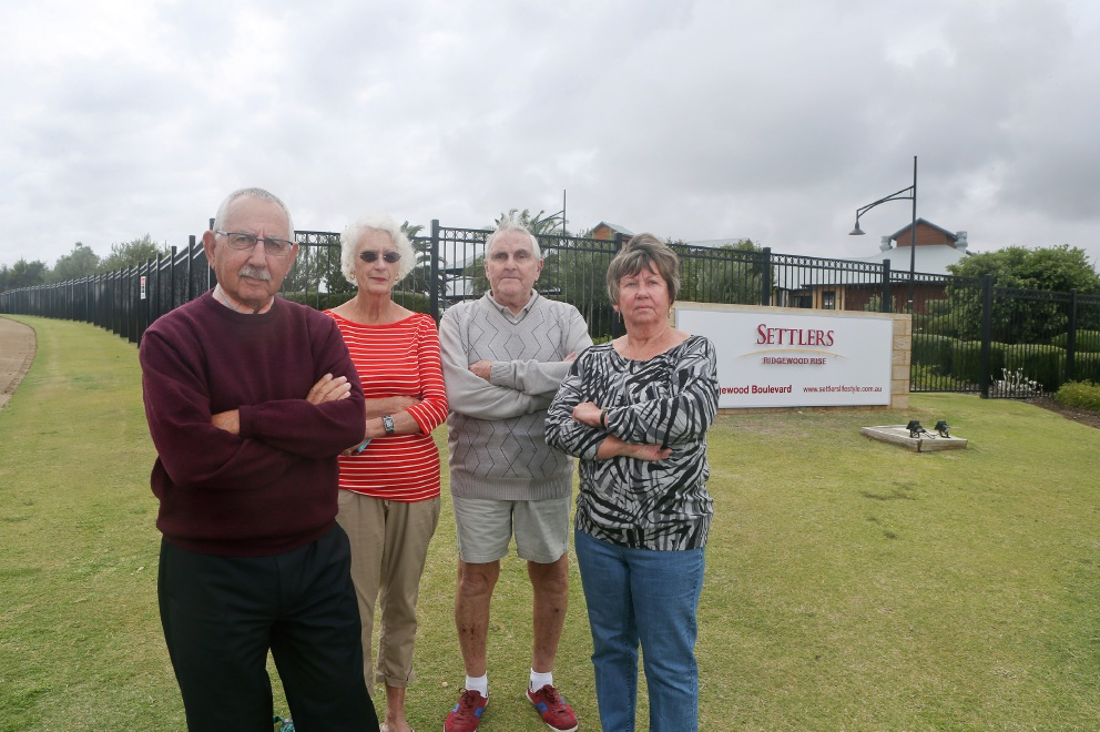 Ray Thompson, Janette Arndt, Bill Allan and Margaret Baldwin. Settlers Rise residents have submitted a petition calling for council to consider applying a differential rating system. Picture: Emma Goodwin d436115