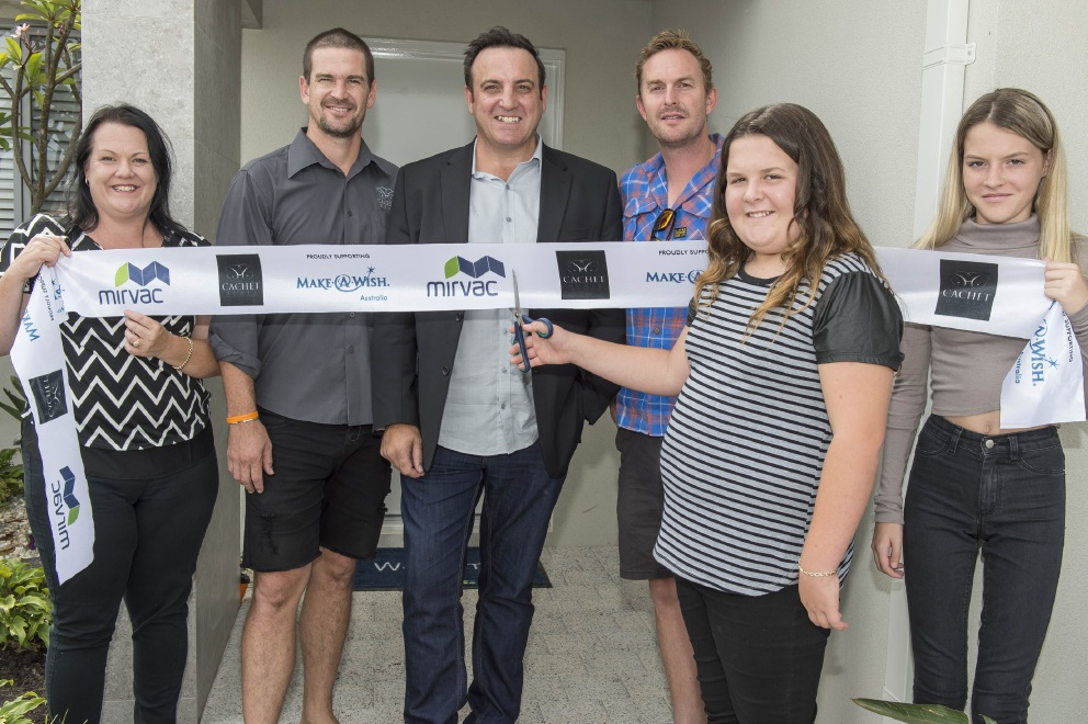 Kelly Collins, Cliff Kearns and Chris Lillis of Cachet Homes, Scott Hine from Make-A-Wish Australia, Brianna Collins and sister Haylee.