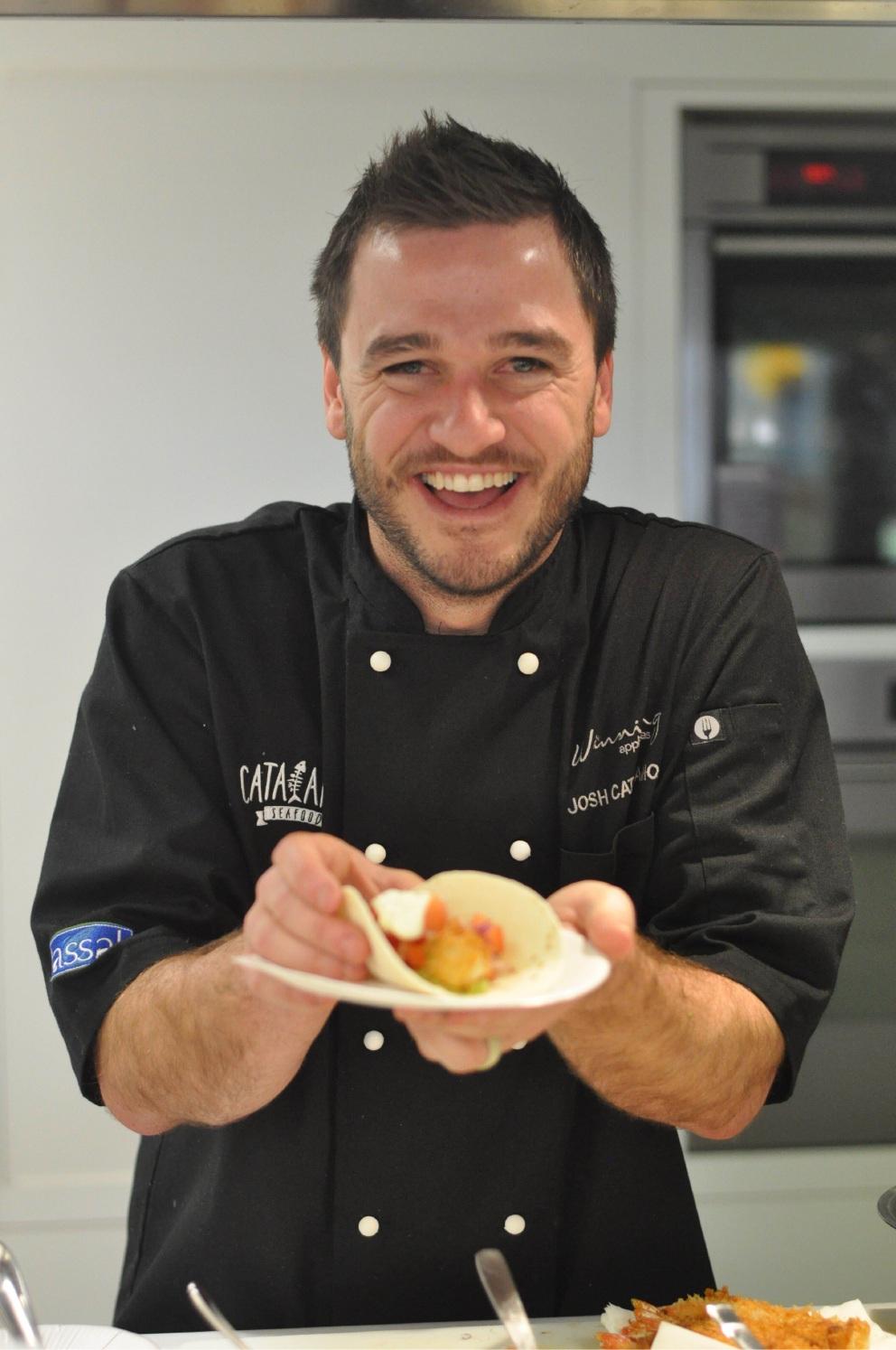 Josh Catalano dishes up a seafood treat.