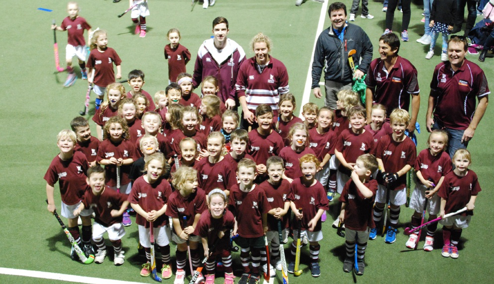 Year One Hook into Hockey players with Melville City team captains Mathilda Carmichael and Tim Geers.