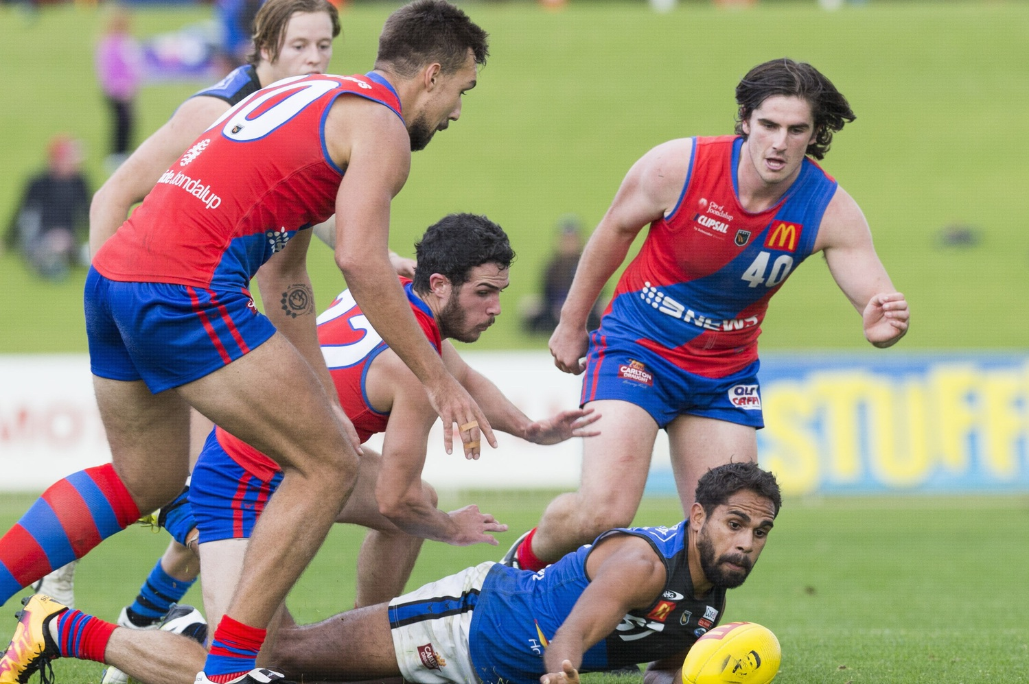 West Perth's Seva Mozhaev, Kris Shannon and Aidan Lynch put pressure on East Perth's Lewis Jetta. Picture: Dan White