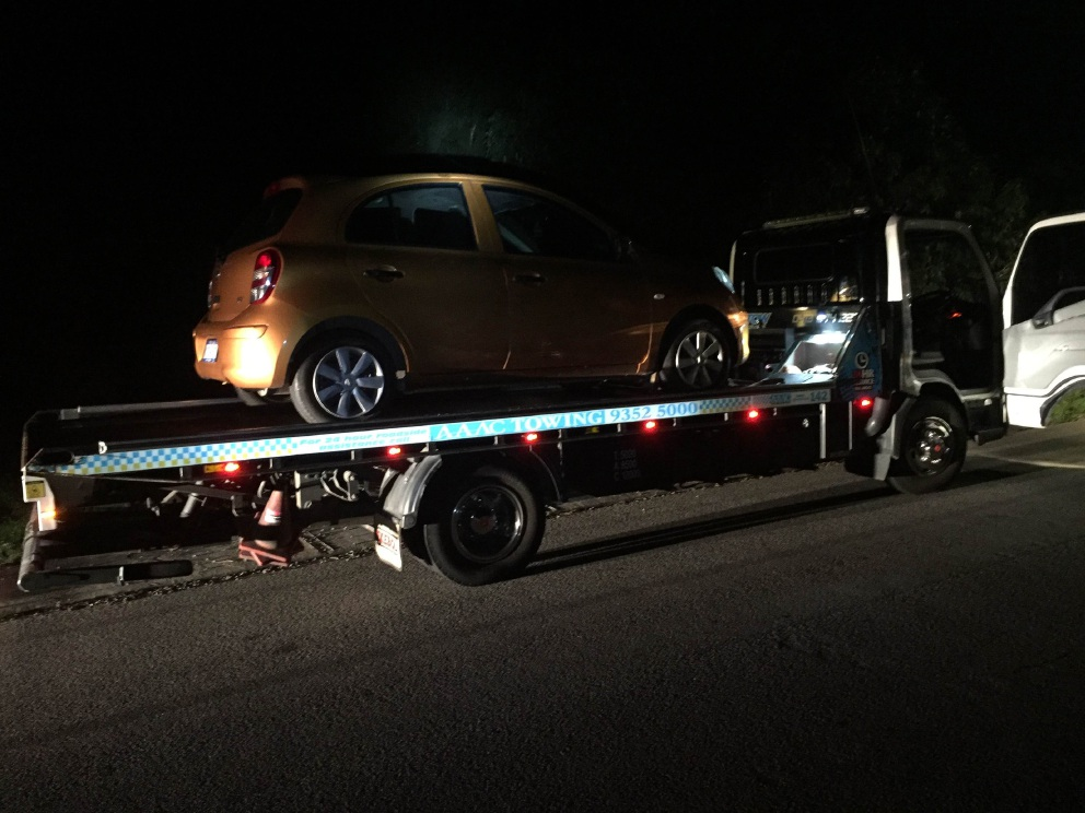 The vehicle being towed after a mother was allegedly caught drink driving.