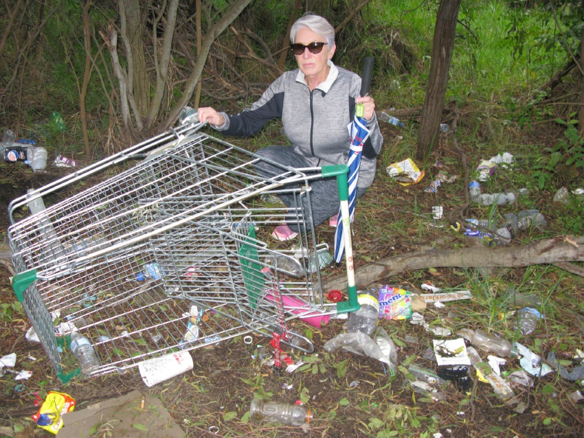 Anchorage resident Vicki Oates with some of the rubbish in the Lake Richmond bushland.