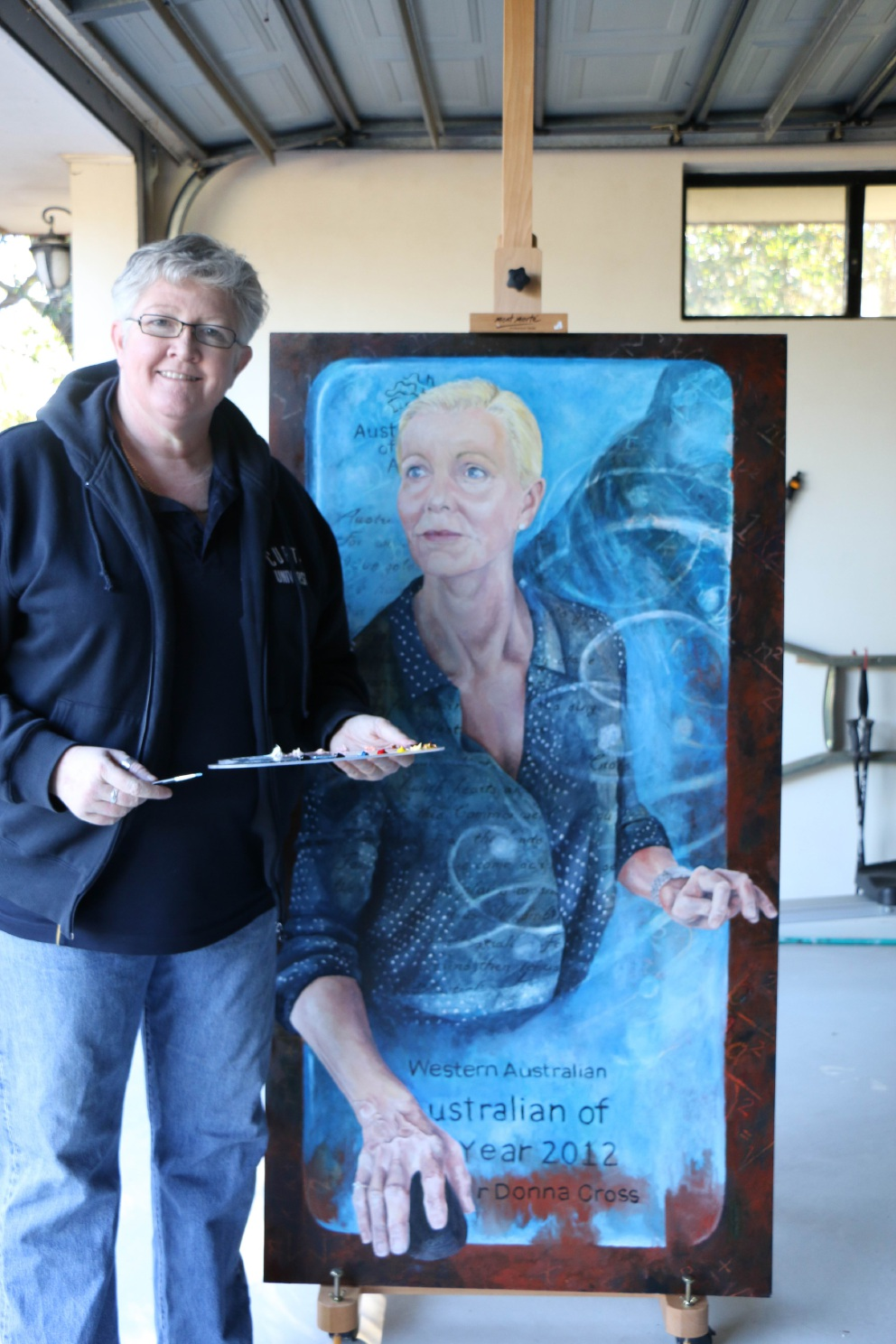 Ann Knight with her portrait of Donna Cross.