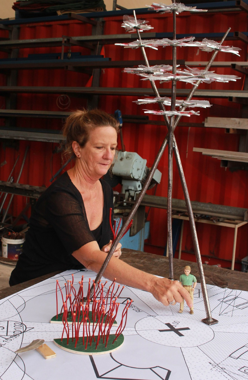 Bridget Norton working on a scale model of the artwork for The Village.