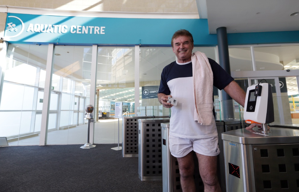 Former Mayor of Joondalup John Bombak, who opened Arena Joondalup 16 years ago, was coincidentally again the first through the aquatic centre's new automated entry gates last month. Picture: Martin Kennealey www.communitypix.com.au   d455036