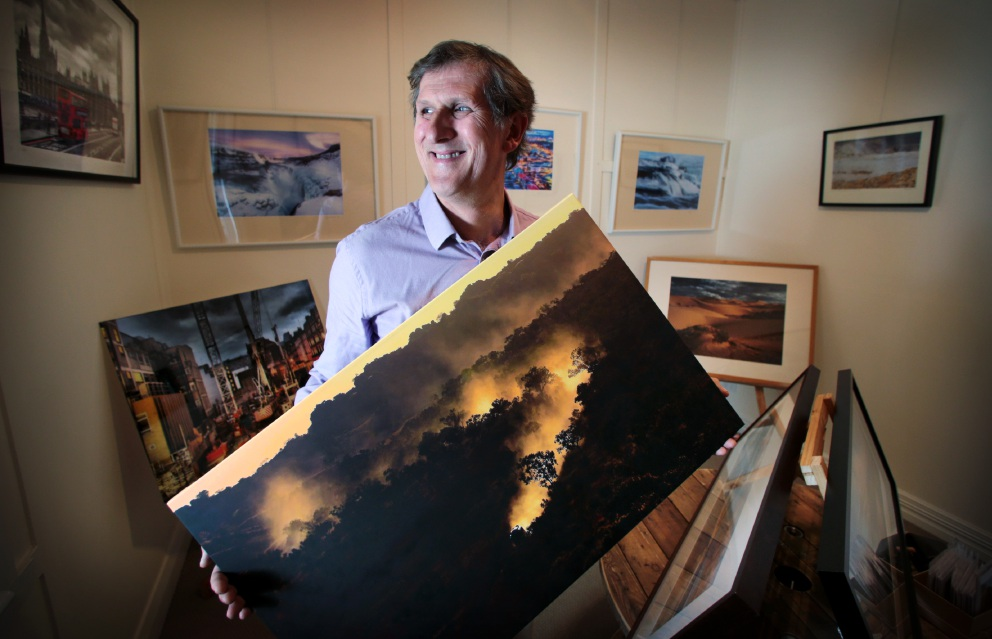 Andy Tyndall with some of his work.         Picture: David Baylis           d455220