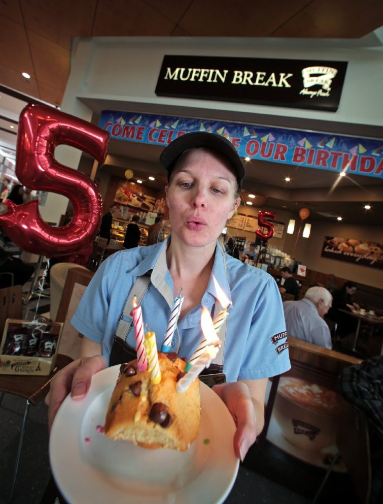 Celeste Light blows out candles on a muffin to celebrate.  Picture: David Baylis                             www.communitypix.com.au   d455344