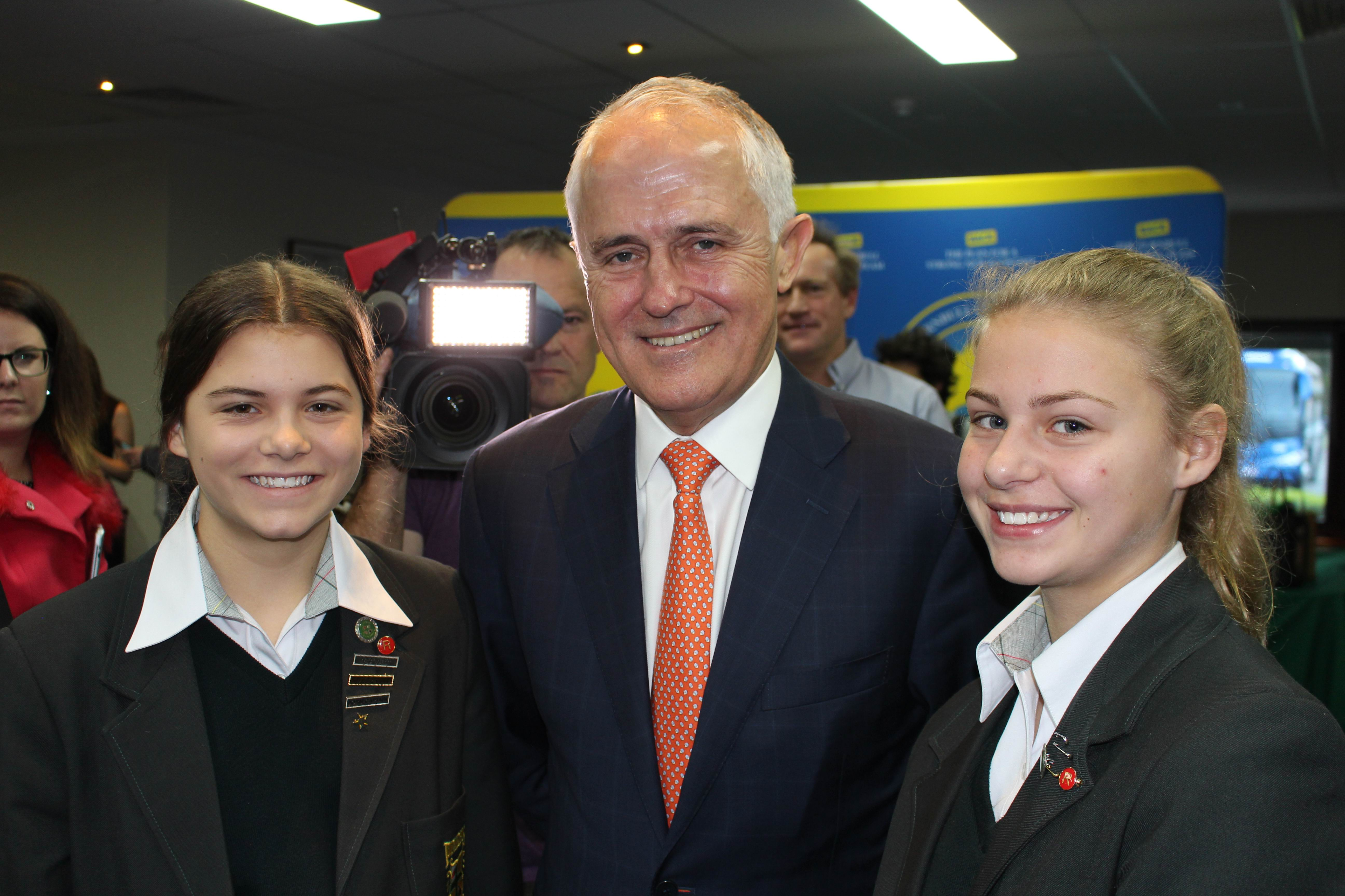 Sophie (14) and Lucy Tyler (13) with Prime Minister Malcolm Turnbull this morning.