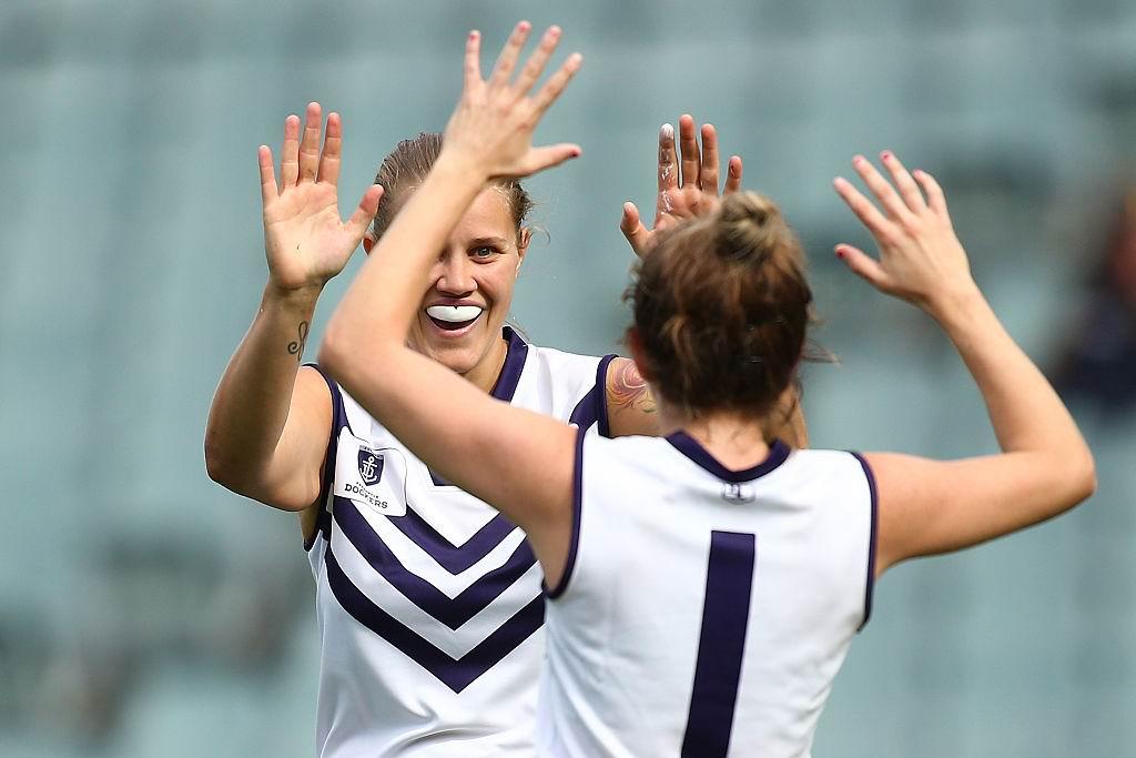Sara Lewis and Cassie Davidson of the Dockers celebrate a goal during the Women's AFL exhibition match between the West Coast Eagles and the Fremantle Dockers at Subiaco Oval. Picture: Getty Images