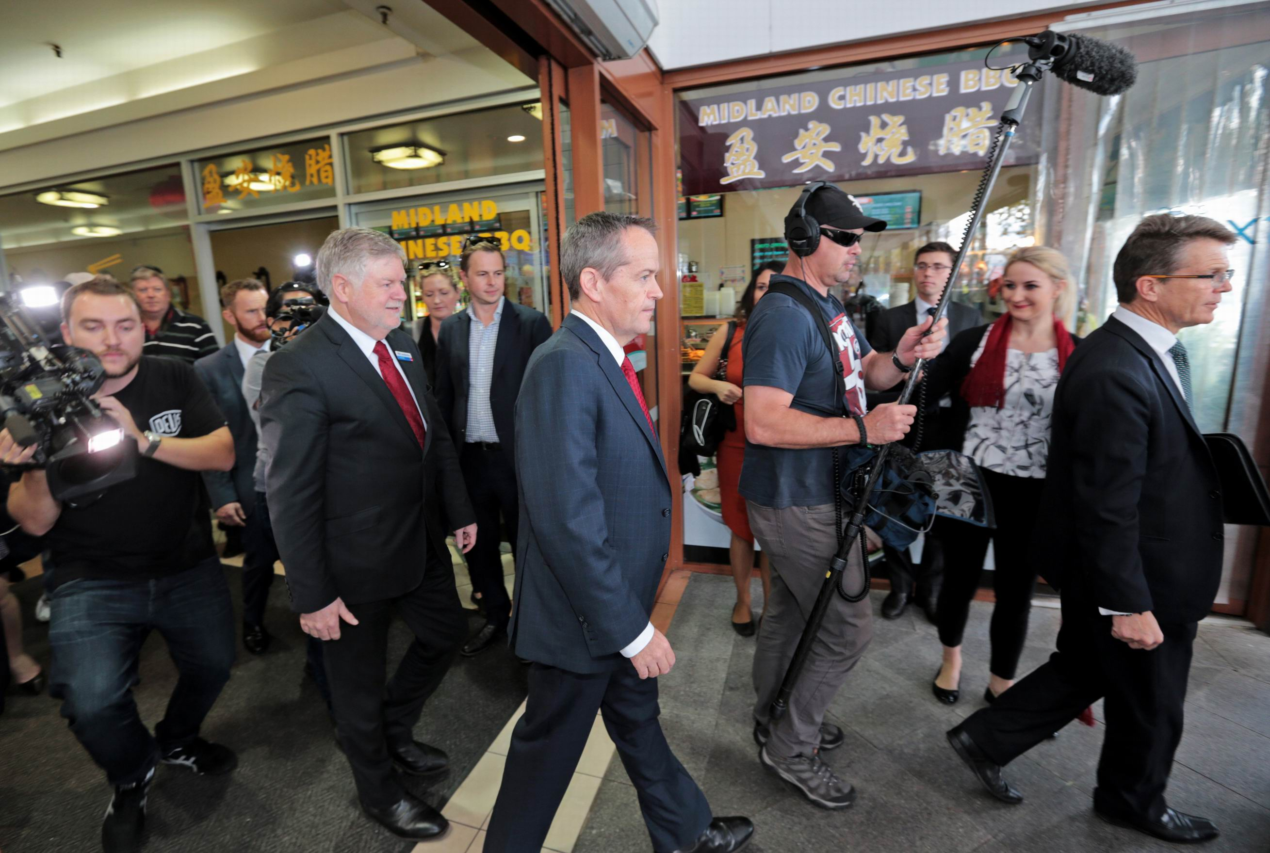 Bill Shorten (centre) followed by ALP Candidate for Hasluck Bill Leadbetter at the Centrepoint Shopping Centre in Midland. Pictures: David Baylis