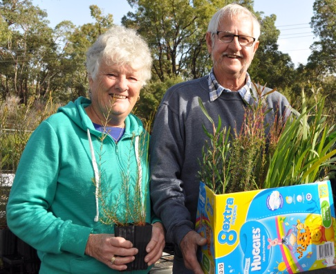 Some grateful residents with their seedlings.