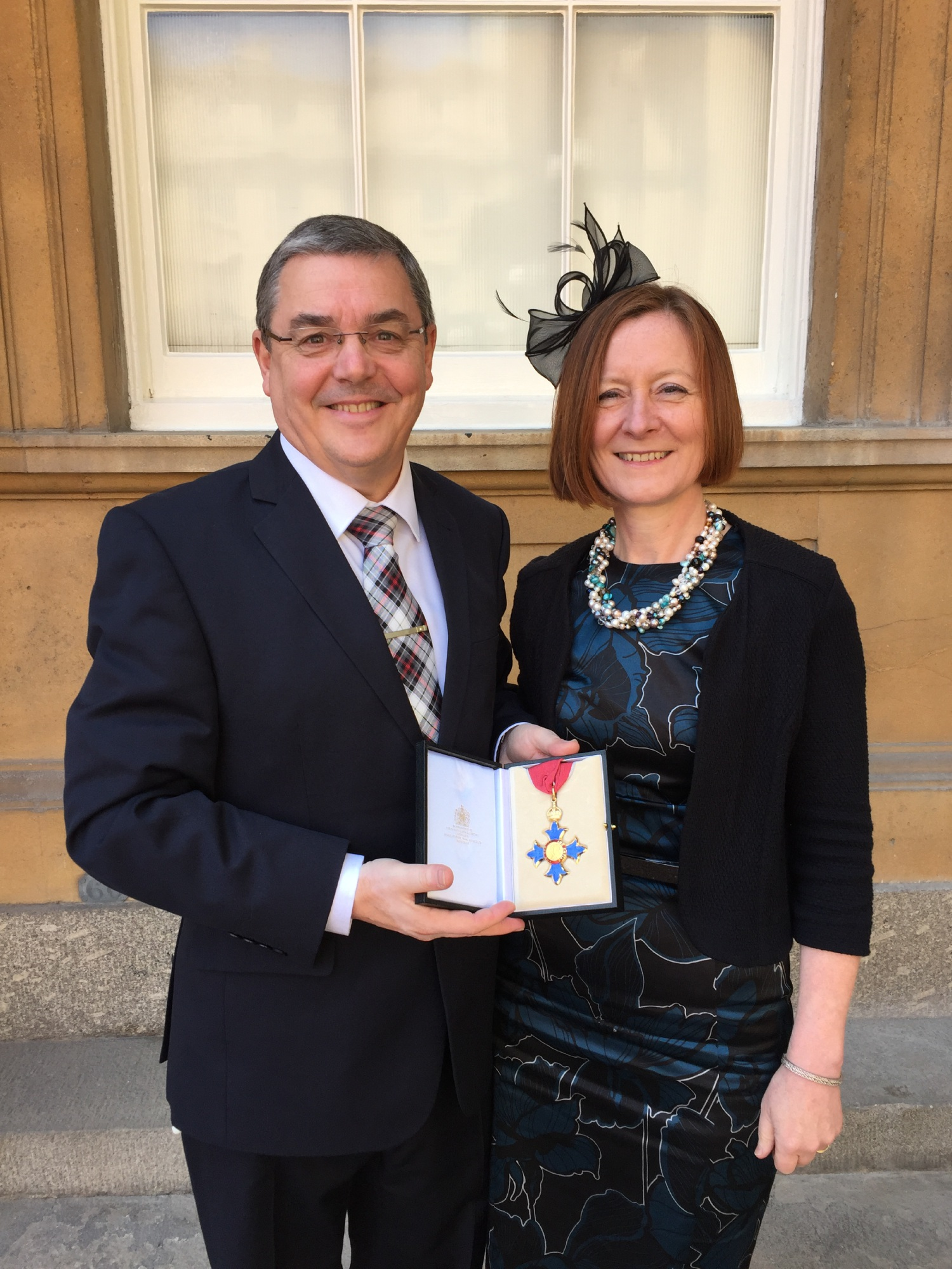 Steve and Karen Chapman in London with his CBE.