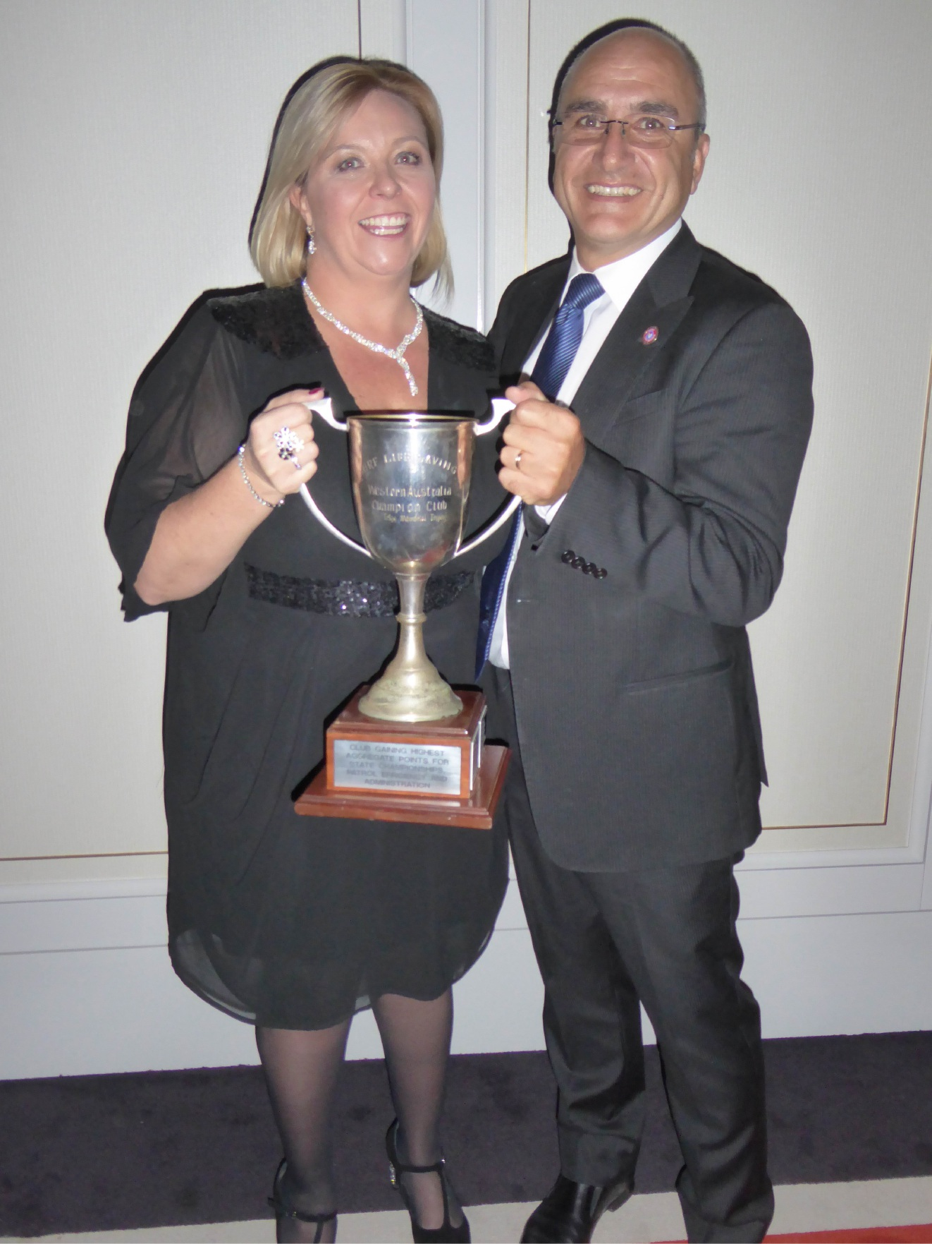 Building committee chairwoman Vicki Rasmussen and president Carlo Tenaglia. Right: Sorrento SLSC winner Garry Bunford.