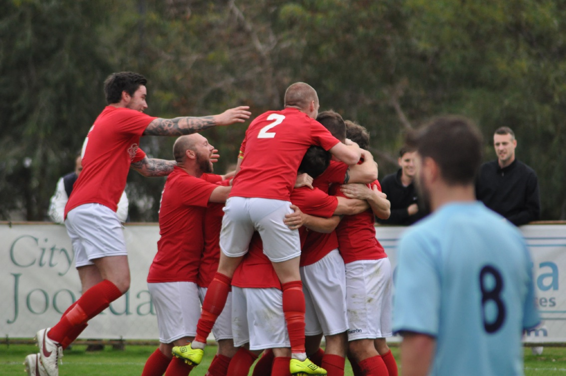 ECU Joondalup celebrate Gordon Smith's second goal. Picture: Peter Simcox