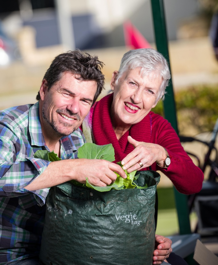 Sustainability expert Chris Fereira with village resident Libby Elliot.