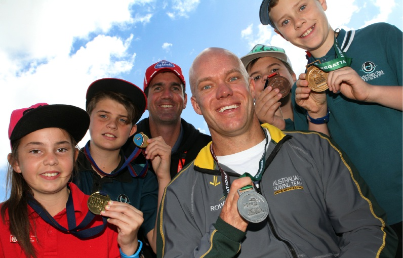 Paralympic rower Brock Ingram and Bletchley Park Primary School senior sports teacher  Clint McNerney with students Jordan Collins, Kade North, Corey O'Leary and Bradley Perman.  Picture: Robin Kornet        www.communitypix.com.au   d454050