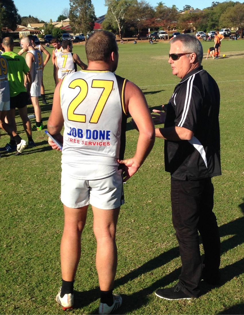 Steve Armstrong talks tactics with assistant coach Mick Outridge.
