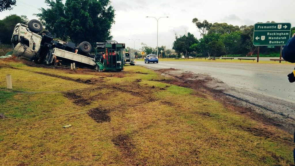 A truck rolled on Thomas Road, Kwinana Beach.