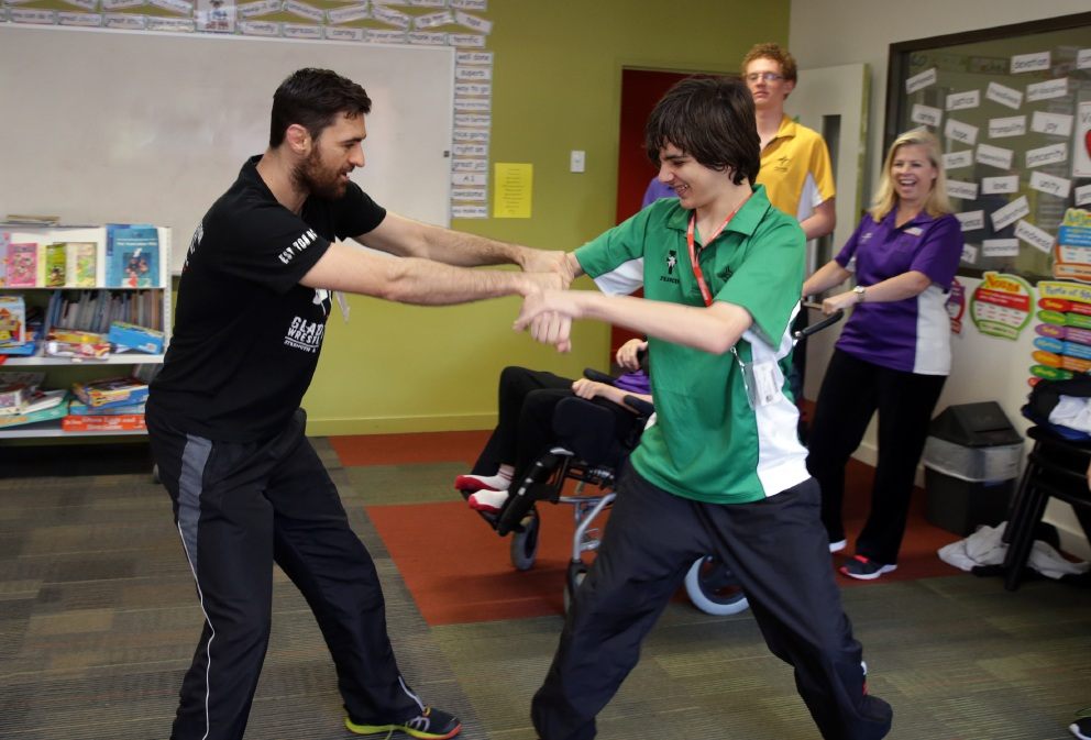 Lance Kinnaird, from Gladiator Wrestling, teaches self-defence to Jacob Staines. Pictures: Martin Kennealey    d454507