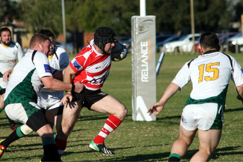 Maxwell Hall tries to bust a tackle for Arks in its clash against the Perth Irish on Saturday.