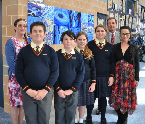 P&F Treasurer Fiona Cerbe with Sacred Heart Primary School students James Conn, Dominic Gianni, Heather Purchase, Mackenzie Flack, Shire President David Lavell and art teacher Juliette Alcock with the artwork created by Year 6 students and partly funded by a Shire of Mundaring Quick Grant.