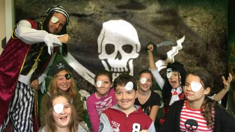 Years 1, 2 and 3 students in pirate dress. Teacher Jeff Melkert with years 4, 5 and 6 students.