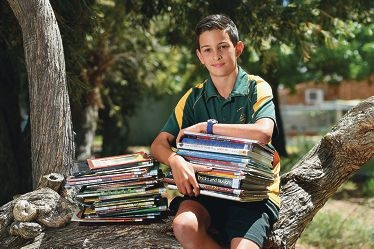 Scarborough Primary School Year 7 student Cristian Fazio has organised a readathon to raise funds for dyslexia. Picture: Marcus Whisson www.communitypix.com.au d428986