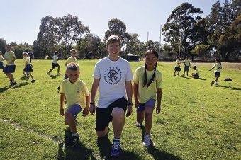 Physical education teacher Fiona Irvine with Wyatt MacDonald and Tina Nguyen. Picture: Emma Goodwin www.communitypix.com.au d428562