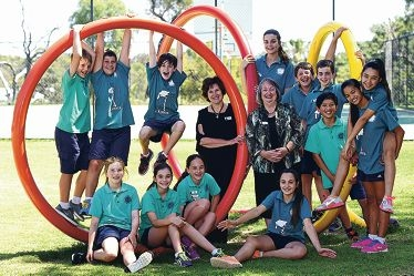 Sutherland Dianella Primary School deputy principal Sue McGinnity (left) and principal Stana Couzic with an energitic group of Year 5 to Year 7 students [NAMES OK]