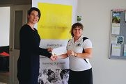 Jackie Lourens from the Ladies Cosmopolitan Golf Club (right) presents funds to Amanda Bright.